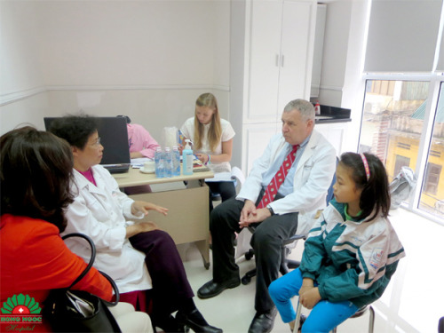 Prof. Rosen examining and giving consultation to a case of ear defect.